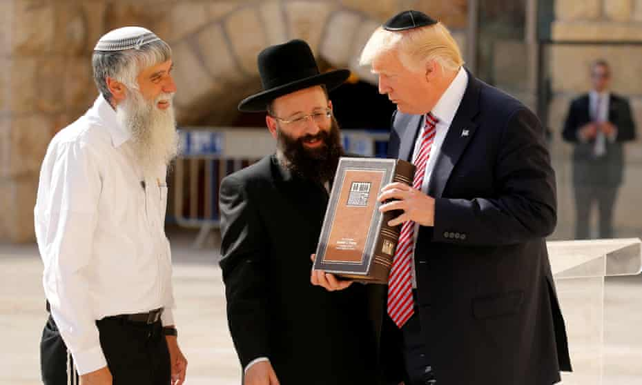 Donald Trump receives a gift at the Western Wall in Jerusalem.