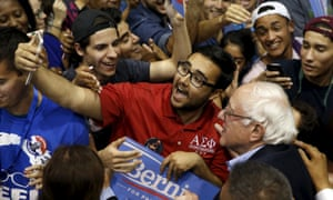 Bernie Sanders poses for a photo after speaking at a rally in Tampa, Florida.