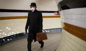 A London commuter braves the coronavirus crisis.