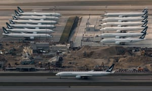 Cathay Pacific aircraft are seen parked on the tarmac at the airport, following the outbreak of the new coronavirus, in Hong Kong.