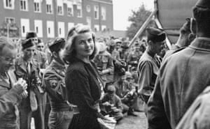 Ingrid Bergman surrounded by GIs in Berlin, 1945. Photograph: Private Collection)