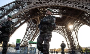 Soldiers at the Eiffel Tower in Paris.