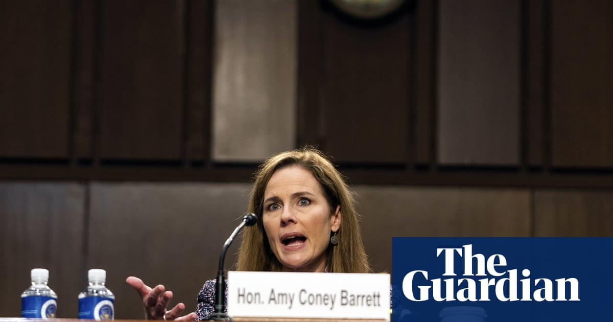 Amy Coney Barrett pledges 'open mind' and plays down conservative record – The Guardian
