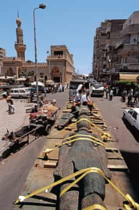 Lying in state ... the statue of a Ptolemaic pharaoh travels through the streets of Alexandria.
