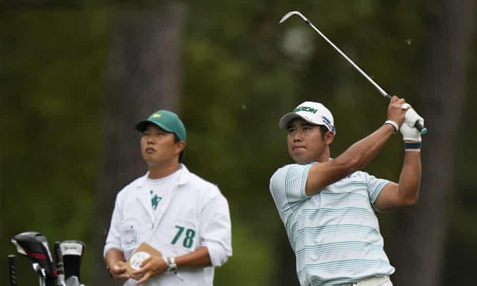 Hideki Matsuyama is watched by his caddie Shota Hayafuji on this way to a magnificent 65.