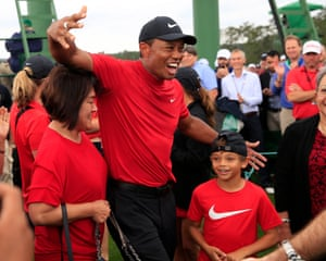 Woods is ecstatic as he celebrates with his family.