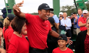 Tiger woods celebrates with his family after winning the Masters again.