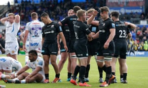 Saracens players congratulate each other after their 38-7 Premiership win against Exeter Chiefs.