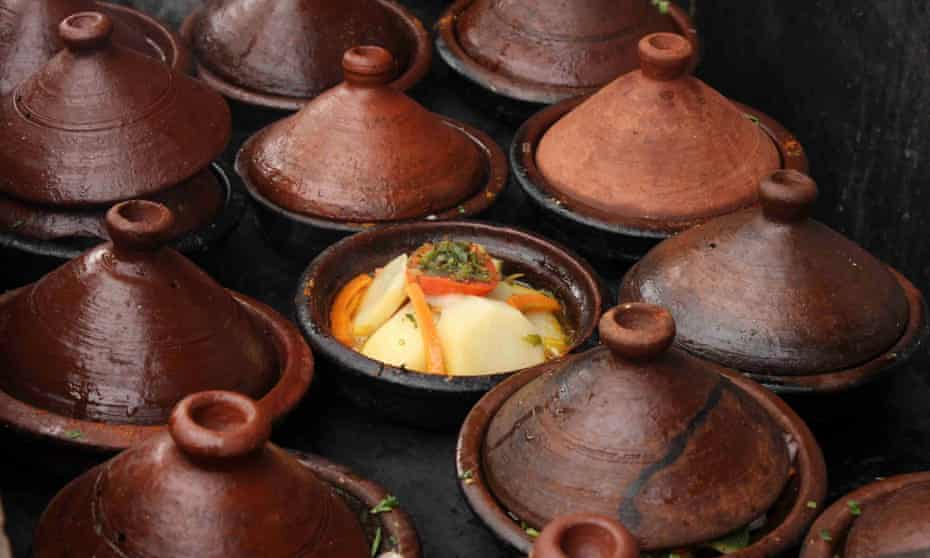Tagines lined up, ready for lunch, at Terrasse Bakchich, Marrakech, Morocco.