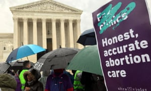 Supporters of a California law, requiring anti-abortion pregnancy centers to post signs notifying women of the availability of state-funded contraception and abortion, hold a rally in front of the US supreme court on 20 March.