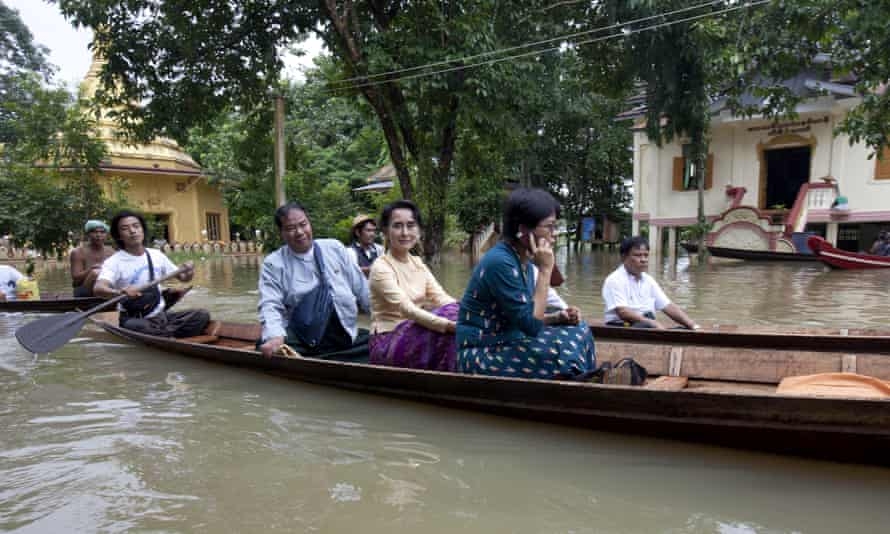 Burma opposition leader Aung San Suu Kyi, centre, on board in Bago, Burma