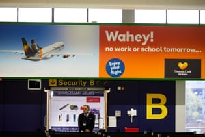Manchester Airport, UK: The deserted Thomas Cook Airline check-in desks at terminal one