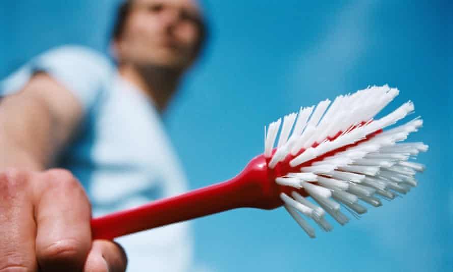 Man holding a washing up brush