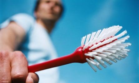 a man holding a scrubbing brush