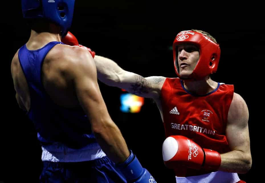 Tony Jeffries (right) in action against Kenny Egan at the Beijing Olympics in 2008. Now a gym-owner, he estimates he was punched in the head between 40,000 and 50,000 times during his boxing career.