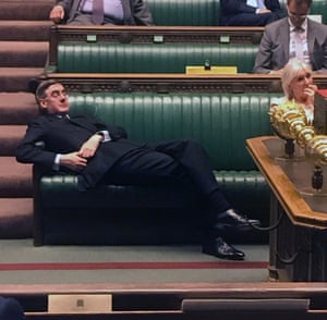Britain's Leader of the House of Commons, Jacob Rees-Mogg, slouches on the front benches during an emergency debate on a no-deal Brexit.
