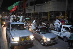 Supporters of Imran Khan ride on vehicles in a convoy in Rawalpindi.
