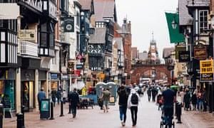Pedestrians shopping in Chester high street, UK