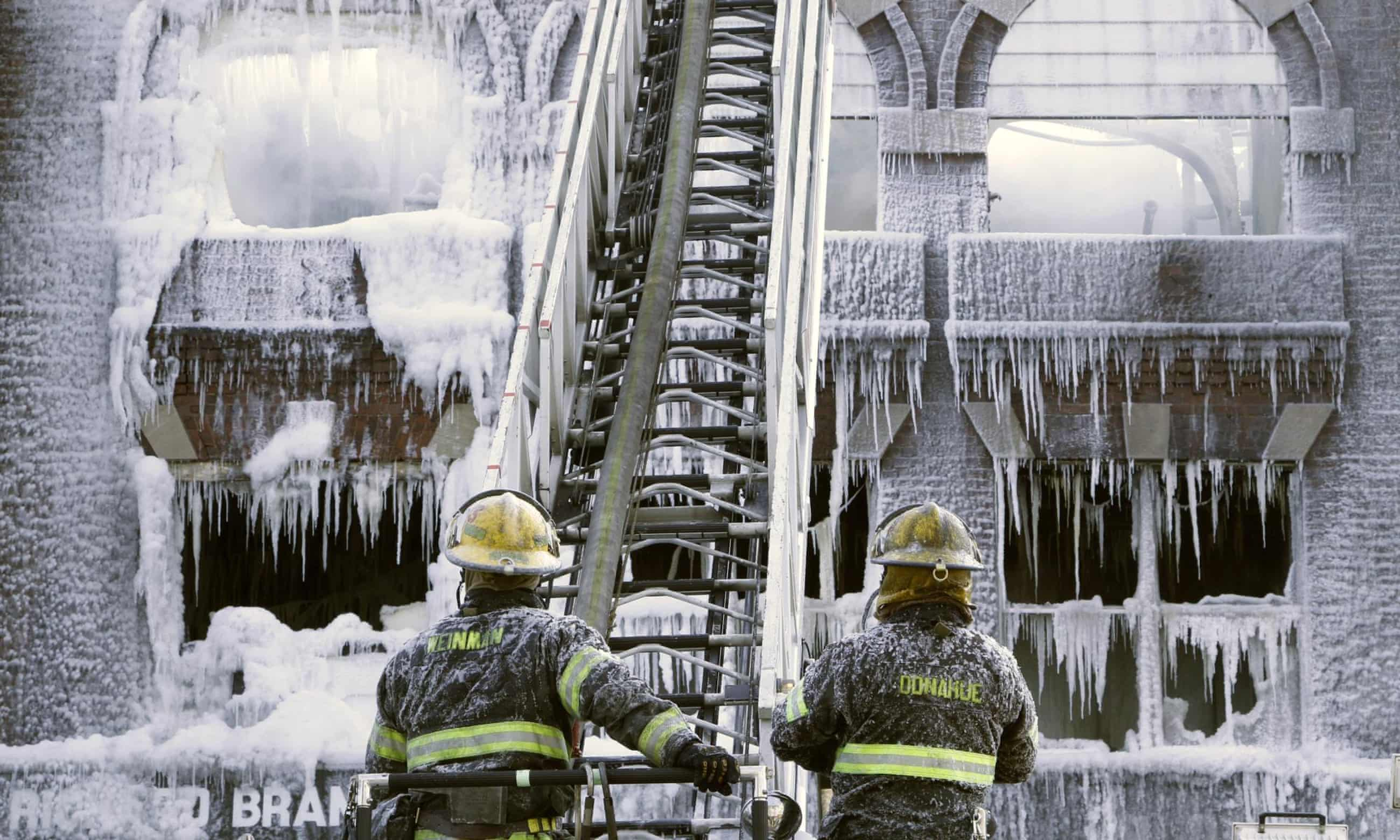 Bitter cold leaves site of Philadelphia fire encased in ice – pictures