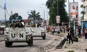 Peacekeepers patrol the streets of Kinshasa during demonstrations against President Kabila