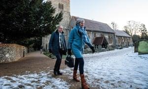 Theresa and Philip May walk near church in Maidenhead