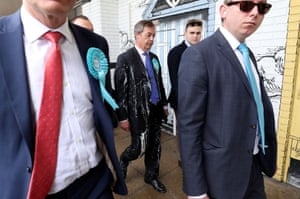 Brexit Party leader Nigel Farage looks glum after being hit with a milkshake on arriving at a European election campaign event in Newcastle, England