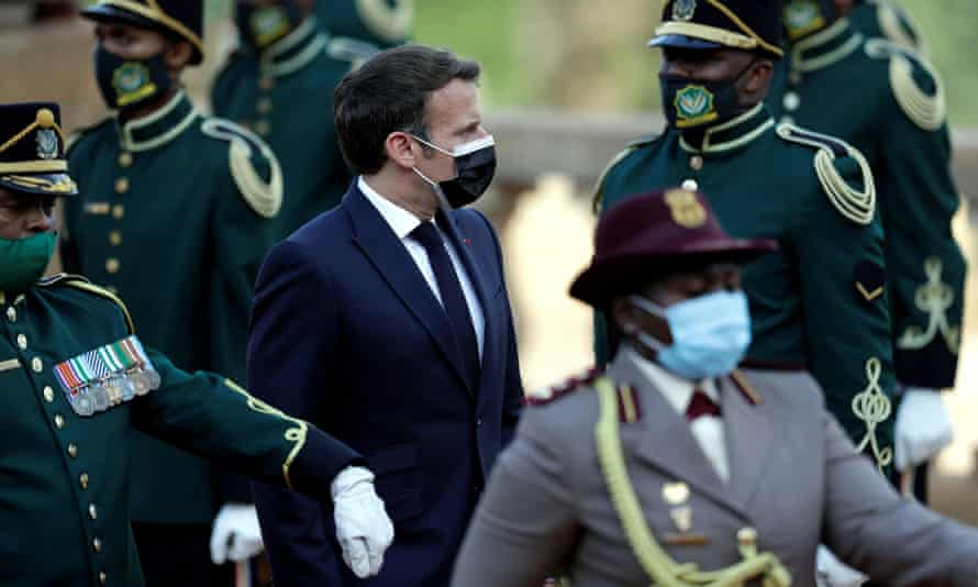 France's President Emmanuel Macron reviews the honour guard during a welcoming ceremony at the government's Union Buildings, in Pretoria, South Africa, on 28 May.