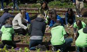 Michelle Obama plants vegetables during the annual White House kitchen garden on Tuesday.