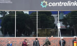 People queue outside a Centrelink office in Preston, Melbourne