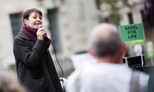 Caroline Lucas addresses Extinction Rebellion activists outside the Ministry of Defence last week.