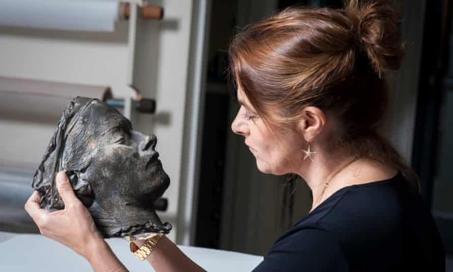 Tracey Emin with her portrait Death Mask.