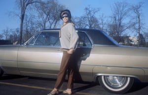 Woman with sunglasses and automobile, c 1970