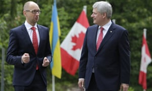 Arseniy Yatsenyuk, left, and Stephen Harper after their meeting in Ottawa on Tuesday.