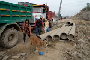 Tired of waiting for their bus to pass through the Kalanki junction, commuters decide to walk