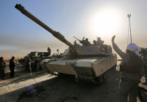 Iraqi forces wave on their way to the city