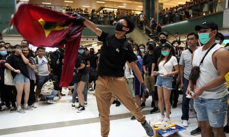 Hong Kong protesters trample Chinese flag as protests continue – video