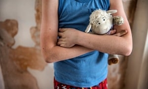 Unidentified child holds a cuddly toy