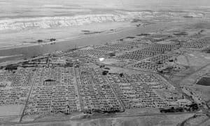 "Aerial view of Hanford Construction Camp, ca. 1945. The camp for construction workers at Hanford ultimately housed upwards of 50,000 people, making it the fourth largest ""city"" in the state of Washington."