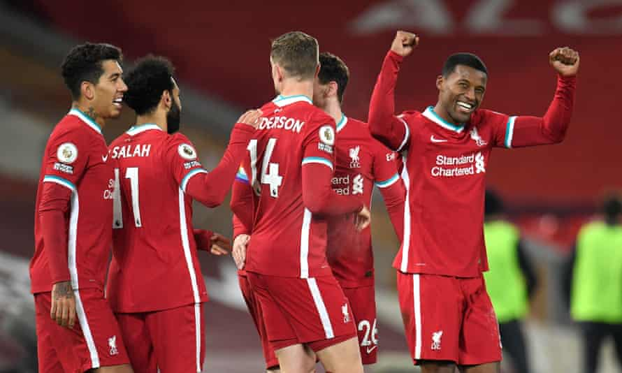 Liverpool players congratulate Georginio Wijnaldum (right) after the midfielder scored the second goal.