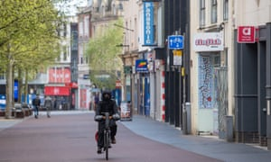 A man cycles along the High Street in Leicester