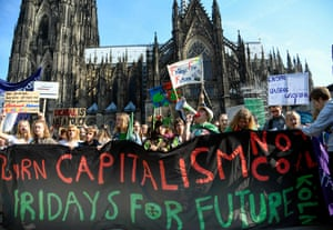 Youth climate activists with banner reading 'Burn capitalism, no coal – Fridays for future'