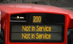 Not in service sign on bus.