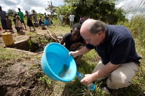 Vidal examining polluted water in the village of Abia, Uganda, during the newspaper's Katine Project that was launched in 2007 to improve the lives of 25,000 of the country's inhabitants.