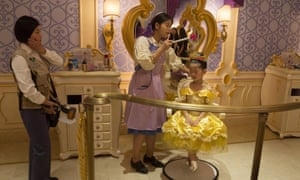 A little girl gets a princess makeover at the Disney Resort in Shanghai.