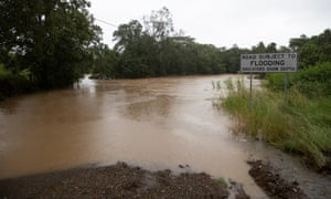 Flooded road where the depth indicators were completely sumbmerged outside Nabiac NSW. Sunday 21st March 2021. Photograph by Mike Bowers. Guardian Australia.