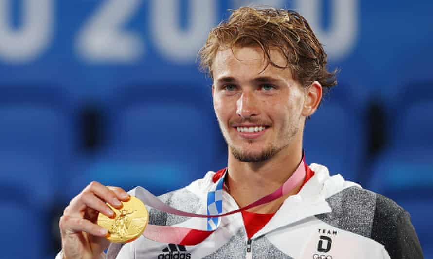 Alexander Zverev of Germany celebrates on the podium after winning gold in Tokyo.