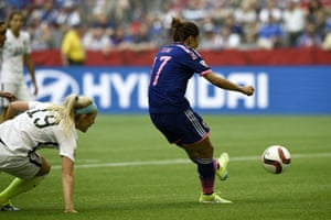 Japan's forward Yuki Ogimi pulls one back.