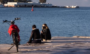 Two women chat in Halkida, a seaside town nearly 80 kilometres northeast of Athens, Greece, on 6 February, 2021.