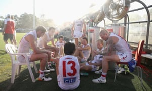 Sydney Swans players swelter at Henson Park on 10 February.