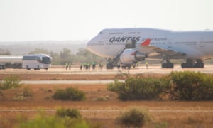 A Qantas 747 plane arrives in Exmouth, Western Australia, with 270 passengers evacuated from Wuhan on 3 February.